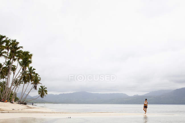 Woman on a secluded beach — Stock Photo