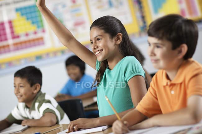 Girl and boys in a classroom — Photo de stock