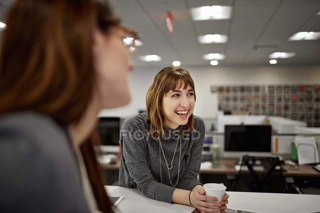 Two women seated in an office — Stock Photo