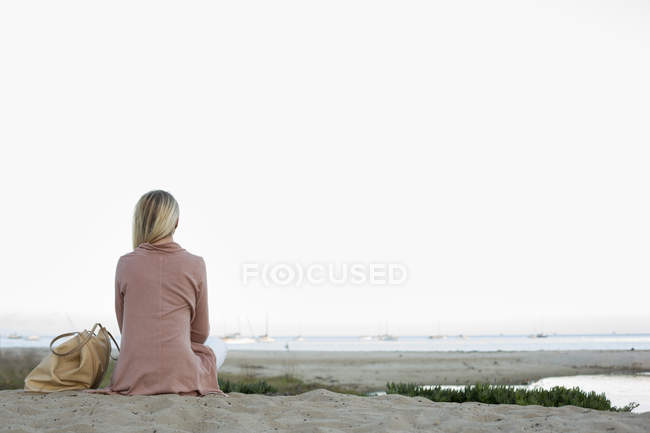 Blond woman on sandy beach. — Stock Photo