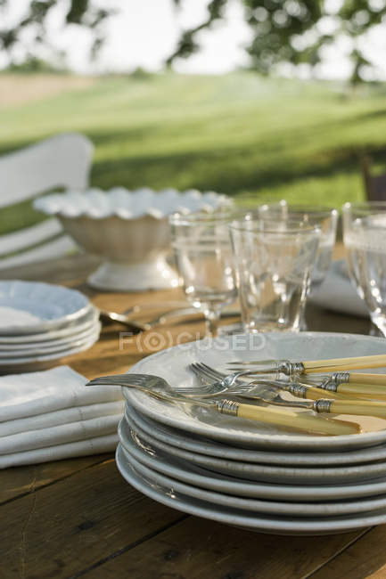 Table laid in a garden — Stock Photo
