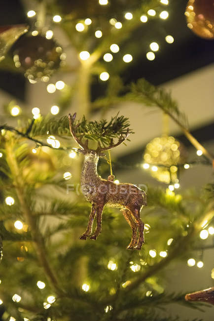 Christmas tree decorated with little deer — Stock Photo
