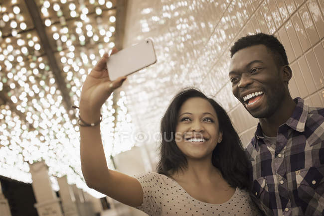 Couple taking a selfy with a smart phone. — Stock Photo
