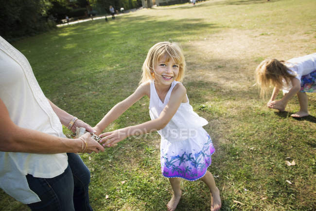 Mother playing with her daughters — Stock Photo