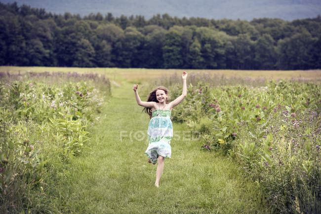 Girl running through a meadow — Stock Photo