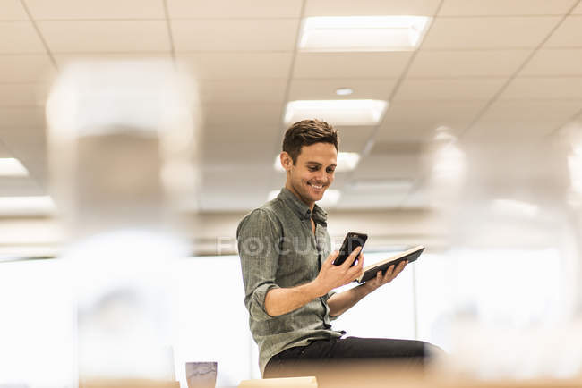 Young man looking smart phone — Stock Photo