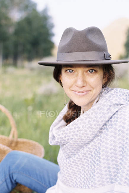 Woman in a hat and woollen shawl — Stock Photo