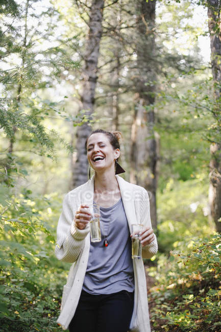 Woman standing in a glade — Stock Photo