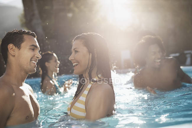 Friends in the swimming pool — Stock Photo