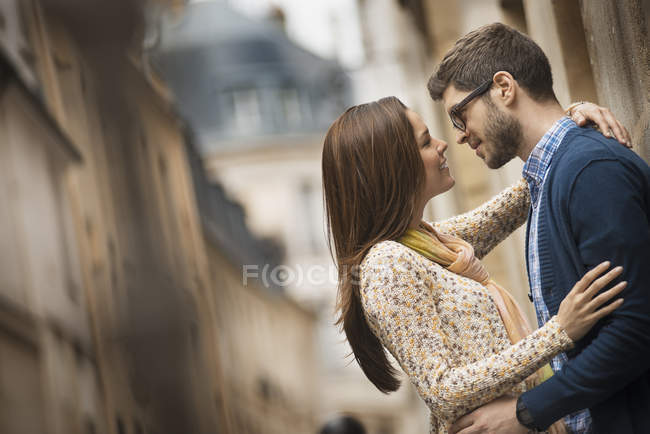 Couple standing gazing at each other — Stock Photo