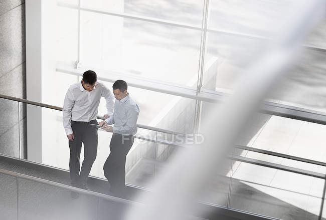 Businessmen by the large windows of a building18686 — Stock Photo