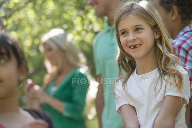 Group of children and adults — Stock Photo