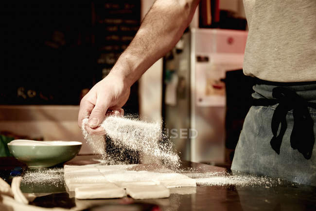Baker working on a floured surface — Stock Photo