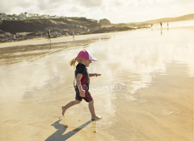 Child in a wetsuit and sunhat — Stock Photo
