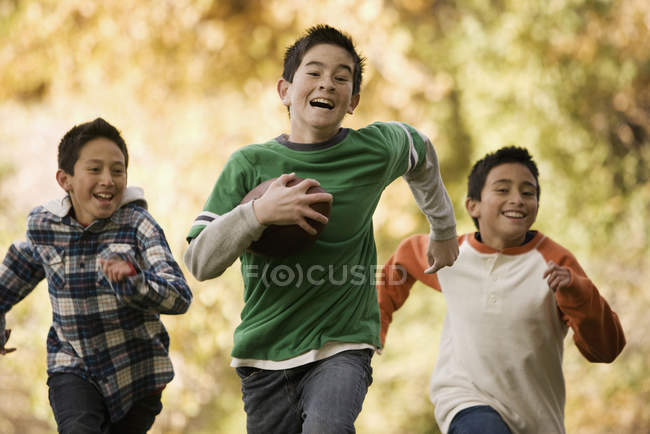 Boys playing football — Stock Photo