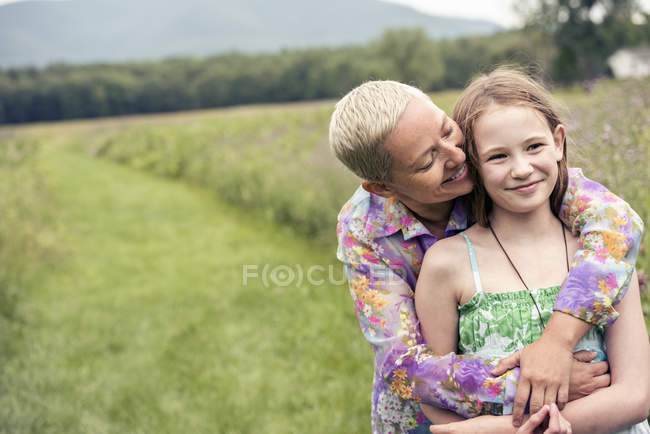 Woman and girl in meadow — Stock Photo