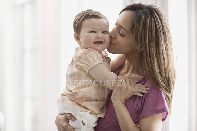 Mother holding little daughter — Stock Photo