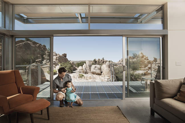 Man and a child in eco house — Stock Photo