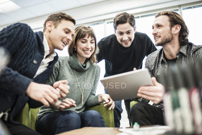 Four people, colleagues at a meeting — Stock Photo