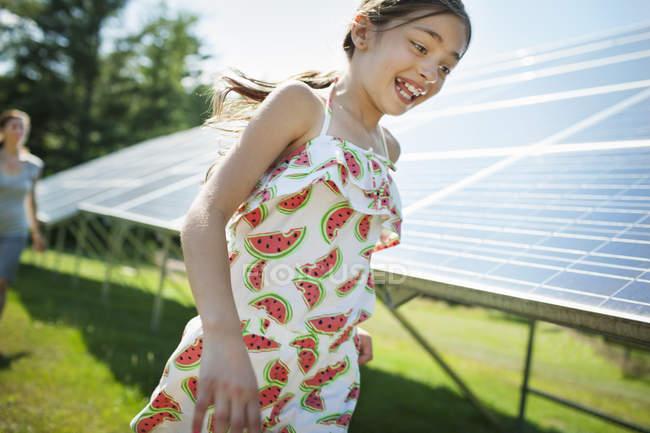 Child beside solar panels — Stock Photo