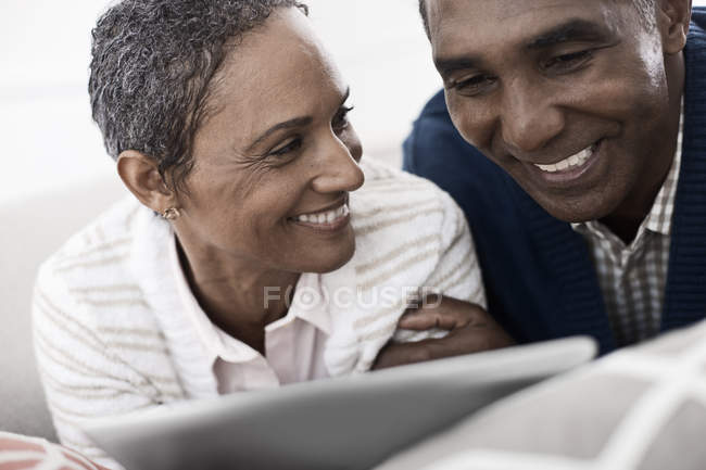 Couple sharing a digital tablet. — Stock Photo
