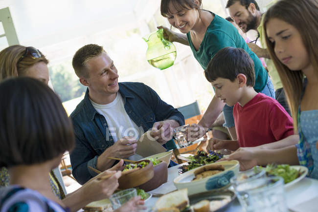 Adults and children on family party in a cafe. — Stock Photo