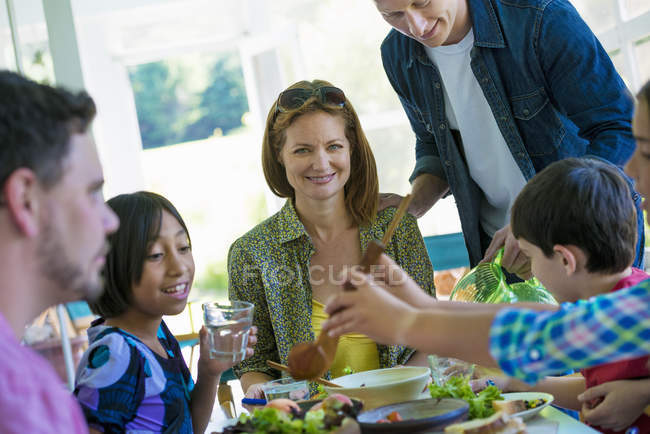 Family party around a table in a cafe. — Stock Photo