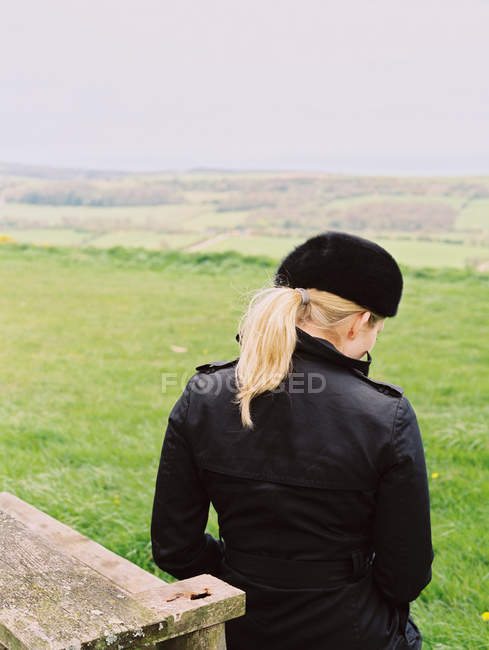 Woman seated on a bench — Stock Photo