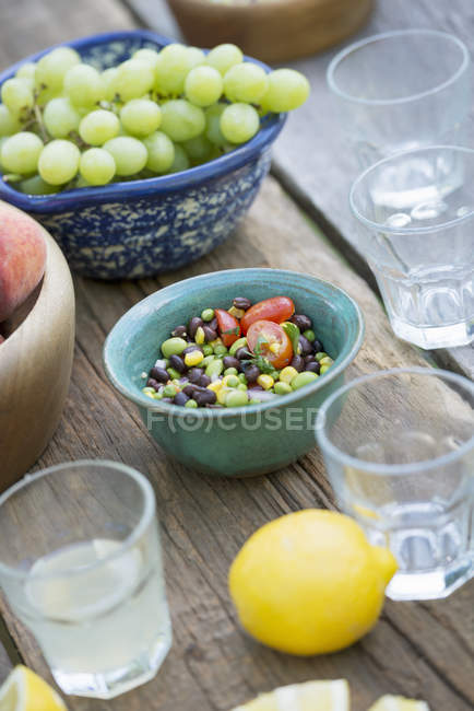 Garden table laid with a buffet of salad — Stock Photo