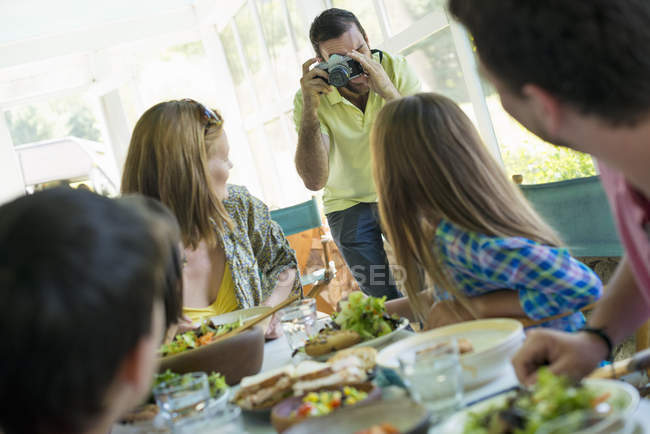 Family party around a table in a cafe — Stock Photo