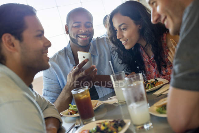 Men and women in cafe — Stock Photo