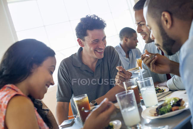Men and woman in cafe — Stock Photo