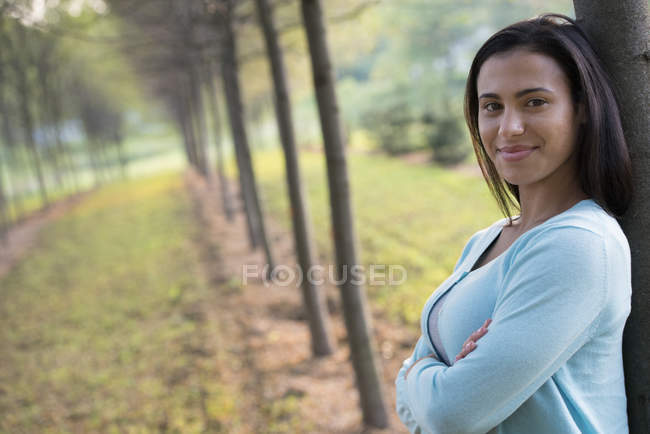 Woman with arms folded — Stock Photo