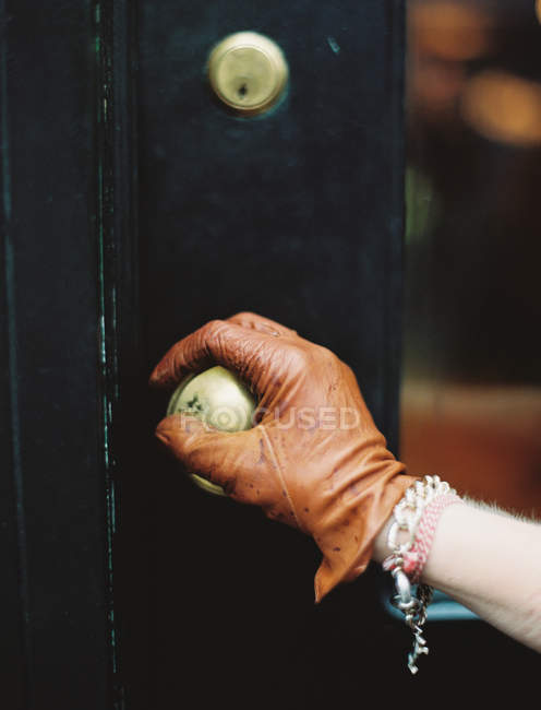 Person opening a door. — Stock Photo