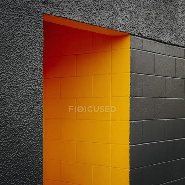 Block concrete wall with doorway — Stock Photo