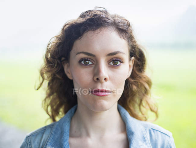 Woman with windblown curly hair. — Stock Photo