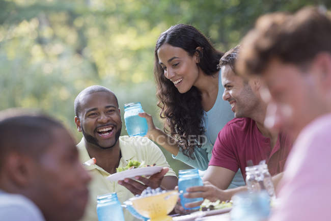 People having meal outdoors — Stock Photo