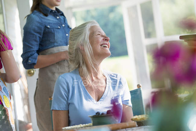 Happy mature woman in a farmhouse — Stock Photo