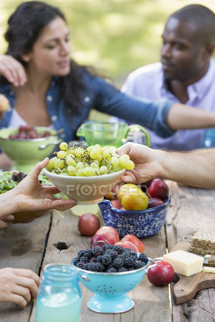 Adults and children eating — Stock Photo