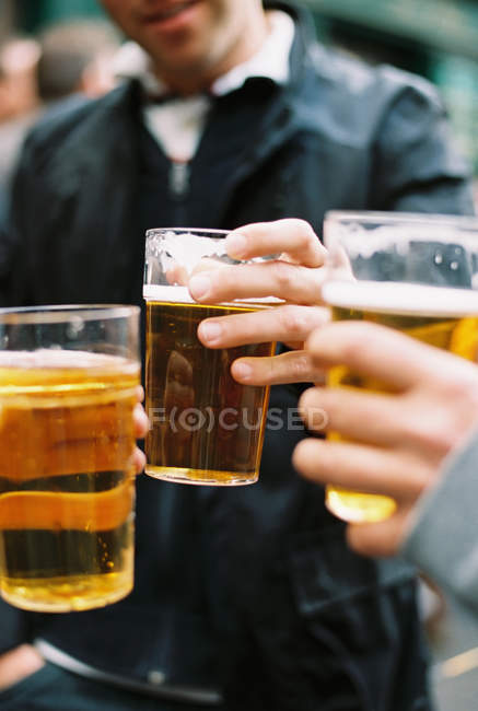 People drinking pints of beer — Stock Photo