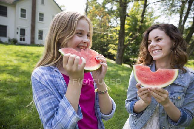 Girl eating watermelon — Stock Photo