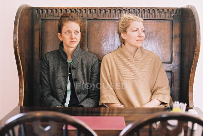 Women Sitting In Traditional English Pub Stock Photo