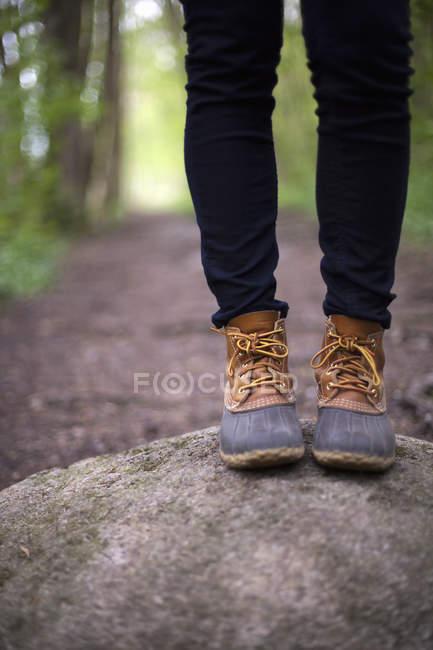 Woman wearing walking boots — Stock Photo