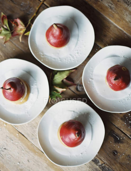 Four plates with desserts — Stock Photo