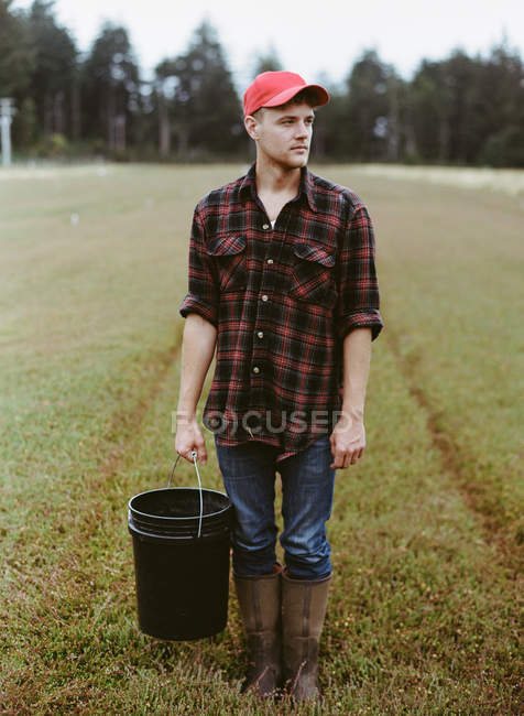 Young man working on land — Stock Photo