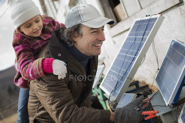 Man with solar power panels. — Stock Photo