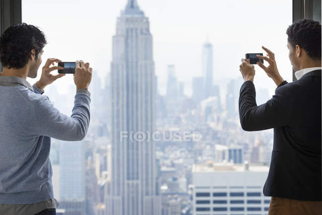 People take images of the city — Stock Photo