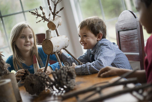 Children with twig reindeer — Stock Photo