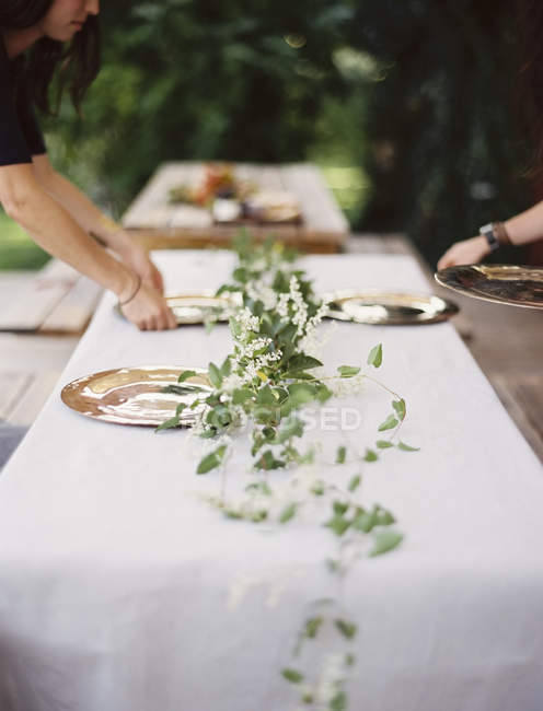 Placing cutlery and plates on a tabletop. — Stock Photo
