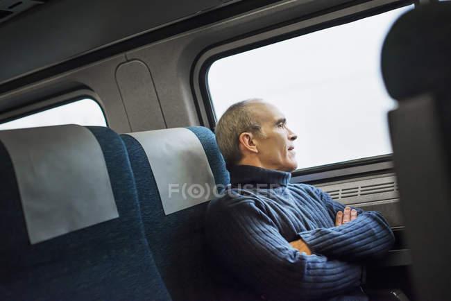Mature man in train — Stock Photo